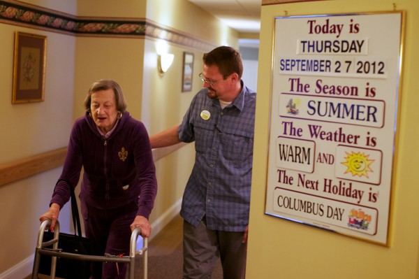 Peter Henckel, program coordinator with Cape Memory Care in Cape Elizabeth, walks and jokes with resident Dorothy Green on Thursday, Sept. 27, 2012.
