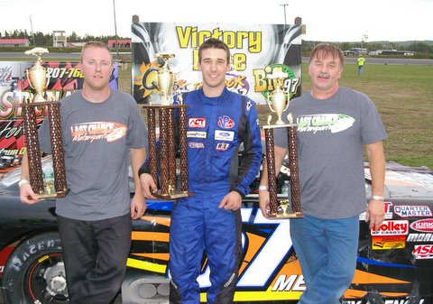 Austin Theriault (center) of Fort Kent shows off his championship trophy in victory lane after winning the Last Chance Motorsports 150 at Spud Speedway on Sunday. Mike Hopkins (left) of Hermon finished second in the race and David Folsom of Skowhegan finished third.