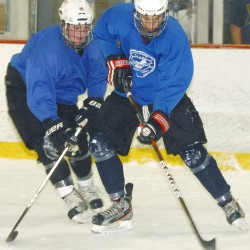 Owen Trundy (left) and Jordan Tracy battle for the puck during a pratice sessions at Penobscot Ice Arena in Brewer, Thursday, Sept. 20, 2012.