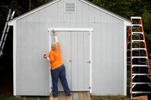 Maine Home Depot employee Sarah Pelletier volunteers her time painting a shed Friday, Sept. 21, 2012 at the Arthur B. Huot Veterans Housing complex in Saco.