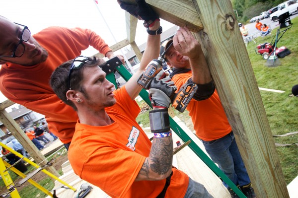 Maine Home Depot workers Brian Johnsen (left), Jake Grant (center) and Ken Cox volunteer their time Friday, Sept. 21, 2012 building a screened gazebo at the Arthur B. Huot Veterans Housing complex in Saco. Over 100 volunteers from Home Depot stores from Ellsworth to Biddeford took part building and painting at the complex as well as at the Veterans Career House in Biddeford.