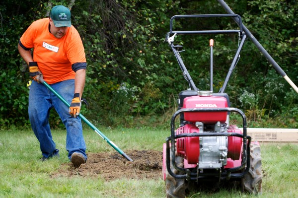 Tree and shrub vendor Bob Beaupre of Greene puts in a garden bed while volunteering with over 100 workers from from 11 Maine Home Depot stores at the Arthur B. Huot Veterans Housing complex in Saco on Friday, Sept. 21, 2012.