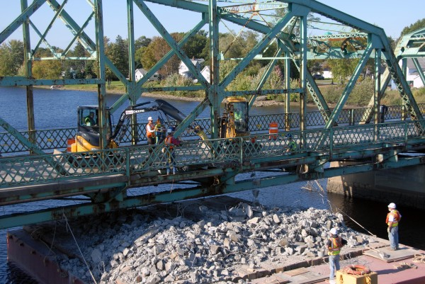 Howland's $10 million Piscataquis River bridge is finished, but Cianbro Corp. workers aren't: Now they have to take down the old bridge. They expect to finish that work in mid-December.