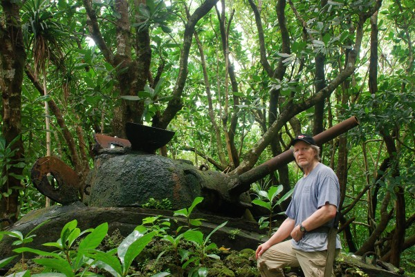 University of Maine at Presque Isle Prof. Anderson Giles locates World War II relics, such as this wrecked tank, by hacking through jungle overgrowth with the help of Tinian residents and historians.