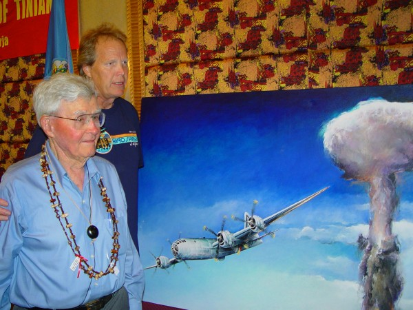 Paul Tibbets (left), pilot of the B-29 bomber Enola Gay, and University of Maine at Presque Isle Prof. Anderson Giles on Tinian in August 2005 during official ceremonies for Giles' commissioned painting of the B-29 bomber Bockscar leaving Nagasaki with the atomic mushroom cloud behind.