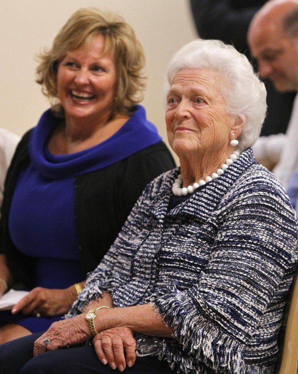 Former first lady Barbara Bush (right) and Maine's first lady Anne LePage listen to remarks at ceremony for Literacy Maine in June 2011 in Biddeford.