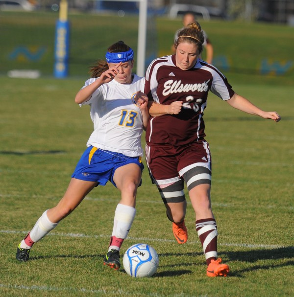 Hermon High School's Maddie Page (left) and Ellsworth High Scool's Morgan Card battle for the ball during the first half of the game in Hermon on Tuesday afternoon, Sept. 25, 2012.