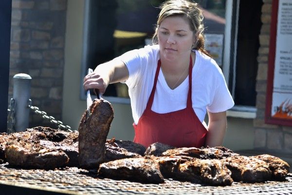 The triangular tri-tip is the bottom end of the sirloin and is difficult to cook but when done right is tender and a favorite of grillers in California. Rayana Pousland grills tri-tips at the Meat Markt in Fresno, Calif.
