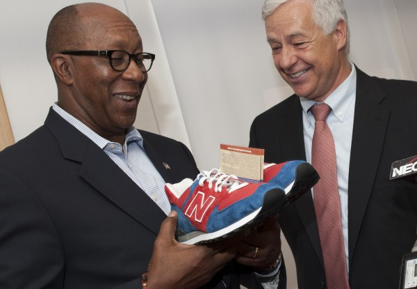 Congressman Mike Michaud (right) presents Ambassador Ron Kirk, U.S. Trade Representative, with a new pair of red, white and blue New Balance running shoes during Kirk's visit to the plant in Norridgewock on Thursday, Sept. 13, 2012.