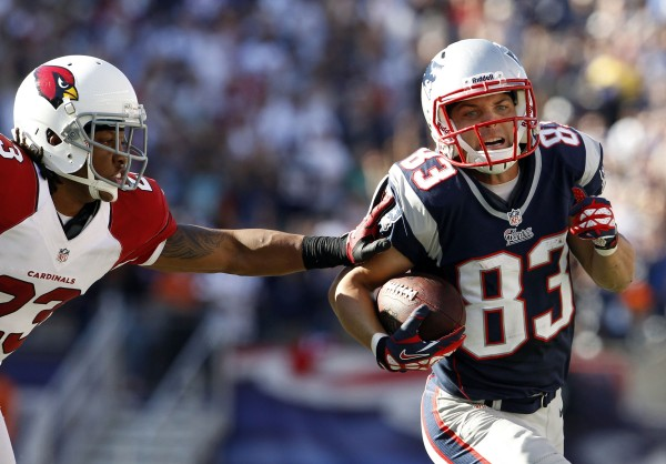 New England Patriots wide receiver Wes Welker (83) runs the ball against Arizona Cardinals cornerback Jamell Fleming during the second half at Gillette Stadium in Foxborough, Mass., on Sept. 16, 2012.
