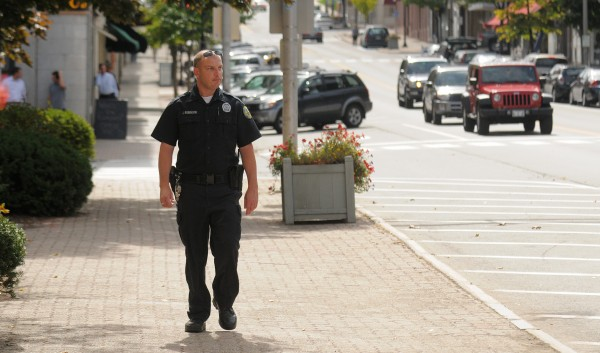 Bangor Police Officer John Robinson walks along Main Street while on foot patrol in Downtown Bangor on Tuesday afternoon, Sept. 19, 2012.