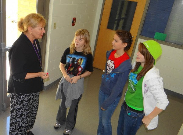 Maryanne Mytar (left), a half-time English teacher and half-time coordinator who oversees a grant-funded intervention program for ninth-graders at Bucksport High School, introduces herself to three of the 60 freshmen whose progress will be monitored through their first year of high school. From left are Lizzie Cusack of Bucksport, Carlie Boyles of Prospect and McCayla Donna of Prospect.