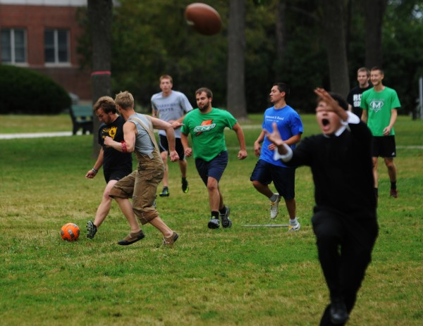 Pickup games of soccer and football unfold on the mall at the University of Maine  on Monday. Life for most University of Maine students went on as usual despite more than 20 summons and five arrests for alcohol and drug violations at an off-campus housing complex over the weekend.