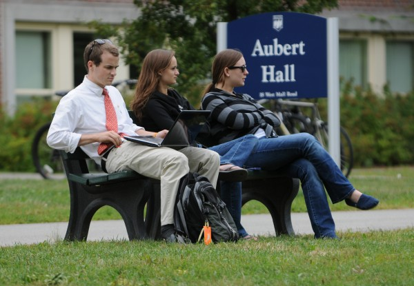 Jacob Ward of Hampden, Casey Williams of Topsham and Sara Rogers also of Topsham sit along the mall on the campus of the University of Maine on Monday. Some students were unaware of the more than 20 summons and five arrests for alcohol and drug violations at an off-campus housing complex over the weekend.