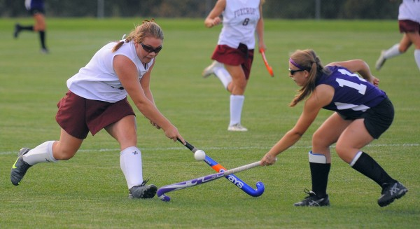 Foxcroft Academy's Mackenzie Coiley (left) and John Bapst Memorial High School's Samantha Ballesteros battle for the ball during the first half of the game in Dover-Foxcroft Monday.