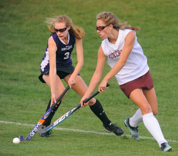 John Bapst Memorial High School's Stephanie Parent (left) and Foxcroft Academy's Julia Annis battle for the ball during the first half of the game in Dover-Foxcroft Monday.