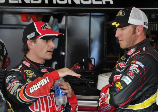 NASCAR Sprint Cup Series driver Jeff Gordon (left) talks with crew chief Alan Gustafson after a crash during the Geico 400 at Chicagoland Speedway on Sept. 16, 2012.