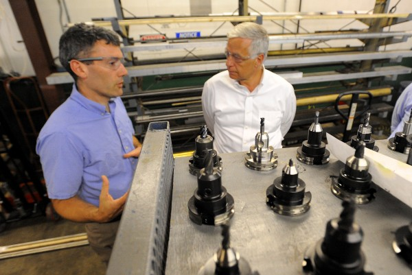 Howard Tool Company general manager Jamie Arsenault (left) talks to Rep. Mike Michaud during his visit to the Bangor company Tuesday, Sept. 4, 2012. Arsenault said that one of the most pressing issues is finding skilled workers for his company which specializes in precision tool manufacturing.