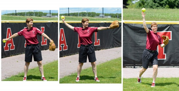 Harvard softball coach Jenny Allard demonstrates proper technique for throwing overhand; here she begins her throw.