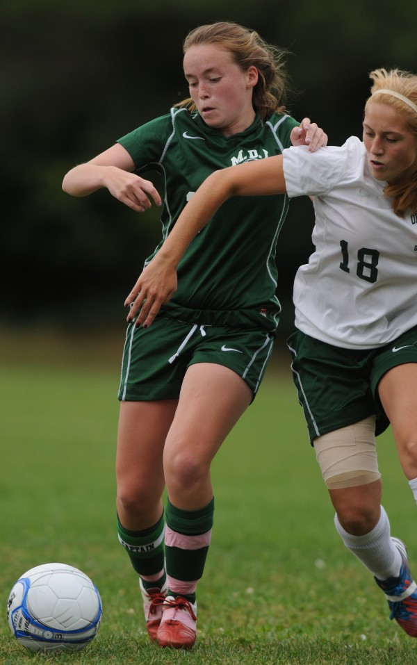 MDI's Allie Stanley and Old Town's Kelsey Hesseltine battle for control of the ball during first half action on Monday at Old Town. Old Town won 1-0.