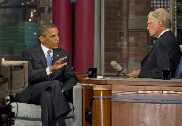 "U.S. President Barack Obama, left, speaks with host David Letterman on the set of the ""Late Show with David Letterman,"" Tuesday, Sept. 18."