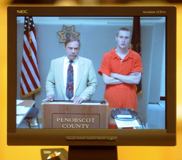 Ryan Petrin appears via video conference for his bail hearing at Penobscot Judicial Center in Bangor on Friday, Sept. 7, 2012. On the left is attorney Dennis Hamrick.