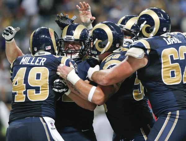 St. Louis Rams tight end Matthew Mulligan (second from left) celebrates his touchdown with teammates during the second half of their NFL football game against the Washington Redskins in St. Louis, Missouri on Sunday, Sept.16, 2012.