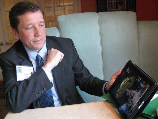 Stephen Bowen, the commissioner of the Maine Department of Education, displays an iPad science app during a conference last year in Augusta.