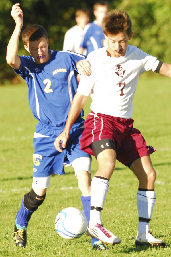Hermon's Matthew Cullens (2) tangles with Orono's Mathew Cloutier (7) during second-half action at the Orono soccer field on Wednesday, Sept. 19, 2012.