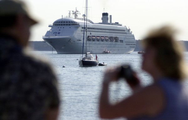 Tourists take in a view of the ocean liner Regal Princess, anchored off Bar Harbor in September 2003. A new study indicates that in 2011, the cruise ship industry's spending in Maine rose nearly 25 percent over 2010.