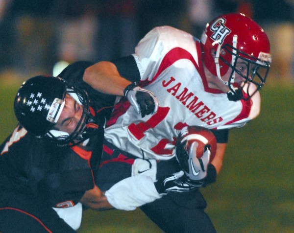 Brewer's Jeremy Bissell (3) takes down Camden Hills' Alex Crans (12) in first-period action at Doyle Field in Brewer on Friday, Sept. 14 2012.