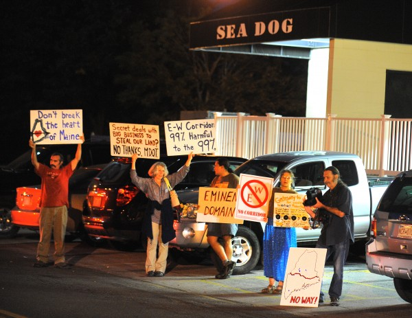 People protest outside the Sea Dog Restaurant on where Cianbro Corporation Chairman and CEO Peter Vigue spoke to members of the Forest Resources Association about the proposed east-west highway Thursday, Sept. 13, 2012.