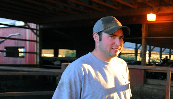 T.J. Wright, 23, is the second of three generations who work on the Misty Meadows Farm in Clinton. He said the price of milk is relatively high but that money does not make it back to the farmers and the grain and fuel costs have gone up sharply. Wright and his father John Stoughton remain hopeful that the the farm will make it through this economic hardship.