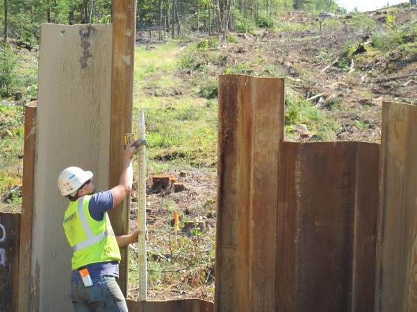 John Nadeu, a foreman with Sargent Corp., surveys the landscape at Grey's Brook, where the Maine DOT will build a &quotbridge in a backpack&quot along a reroute of Route 180 in Ellsworth.