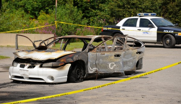 A burned-out car with three bodies inside was found in Target Industrial Circle in Bangor on Monday, Aug. 13, 2012.