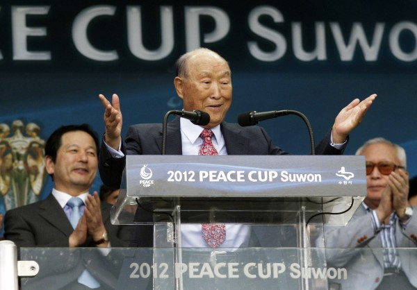 The Rev. Sun Myung Moon, the controversial founder of the Unification Church, speaks during the opening ceremony of the 2012 Peace Cup Suwon in July at Suwon World Cup Stadium in Suwon, South Korea. Moon, who founded the Unification Church in Seoul in 1954, died on Monday in South Korea. He was 92.