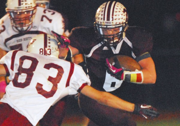 Foxcroft Academy's Alex Stevens (6) breaks free of a tackle from Orono's Justin Szeker (83) during first-quarter action at Dover-Foxcroft, Friday, Sept. 28, 2012.