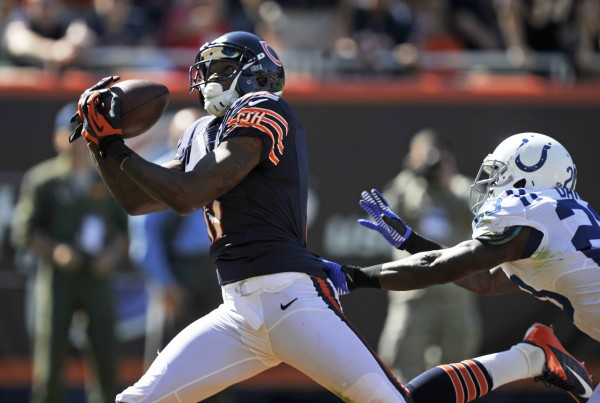 Chicago Bears wide receiver Alshon Jeffery (17) makes a 42-yard touchdown reception past Indianapolis Colts cornerback Vontae Davis (23) during the second half of an NFL football game in Chicago on Sunday, Sept. 9, 2012.
