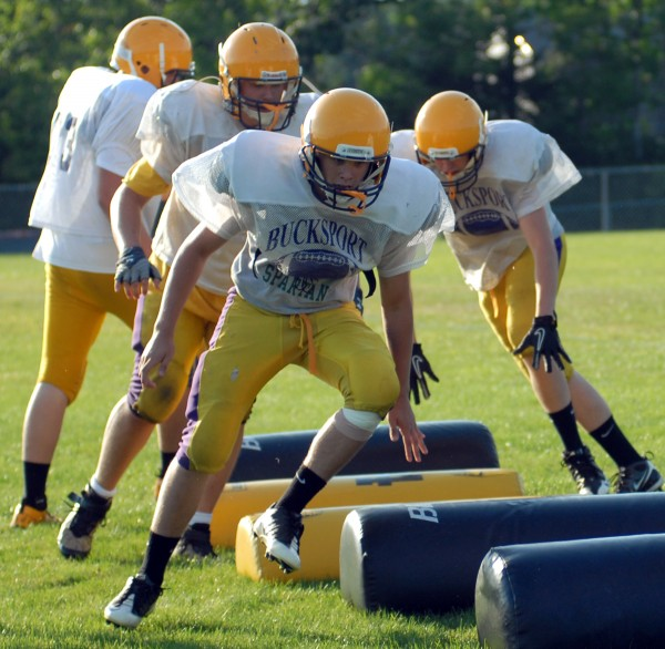 Members of the Bucksport football team practice on Aug. 30, 2012.