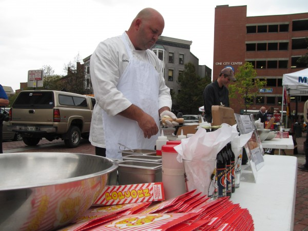 Christian Gordon of the Sea Dog Brewing Co. in South Portland whips up one of three unique snacks he developed based on the main ingredient of Boy Scout popcorn Wednesday afternoon, Sept. 26, 2012. The Boy Scouts Pine Tree Council held the popcorn cooking challenge in Monument Square in Portland to raise awareness for their annual popcorn sale fundraiser.