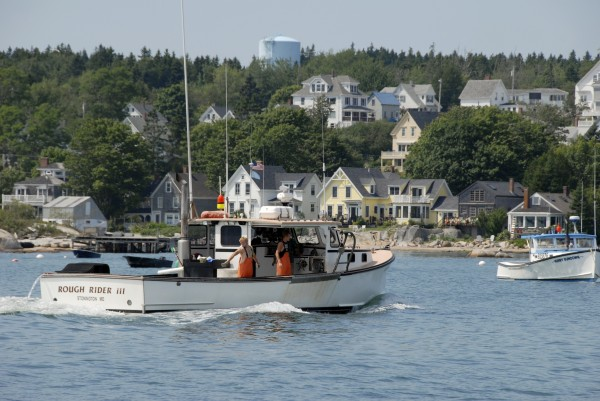 The lobster boat Rough Rider III cruises into Stonington Harbor after a day spent hauling lobsters.