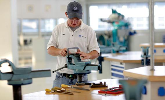 At Volkswagen's Chattanooga, Tenn., plant, some computer robotics workers come through a German-style apprenticeship program created in partnership with a local community college.