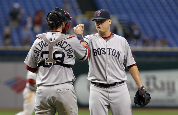 Boston Red Sox relief pitcher Andrew Bailey (40) and catcher Jarrod Saltalamacchia (39) congratulate each other after they beat the Tampa Bay Rays Tuesday night, Sept. 18, 2012, at Tropicana Field. Boston won 7-5.