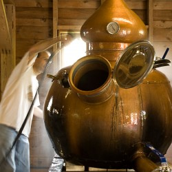 Keith Bodine, owner of Sweetgrass Farm Winery and Distillery in Union, tends the still.