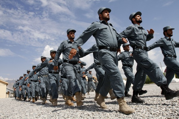 Afghan national police officers march during a graduation ceremony at a National Police training center in Laghman province, east of Kabul, Afghanistan on Monday, Sept. 10, 2012. Over 148 National police officers graduated after receiving four months of training in Laghman.