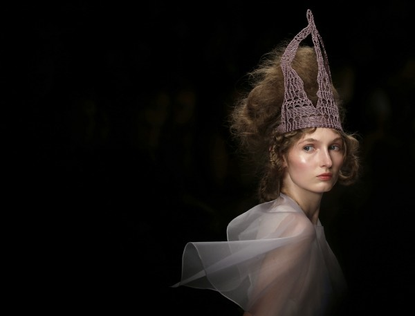 A model presents a design by Bora Aksu during his spring/summer 2013 show at London Fashion Week in London on Friday, Sept. 14, 2012.