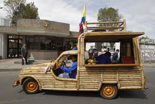 Jose Mauricio Pardo drives his bamboo vehicle through the streets of Bogota, Colombia, Friday, Sept. 28, 2012. The vehicle composed almost entirely of bamboo was designed by Pardo, a Colombian plastic artist. The original car parts include the car engine and tires.