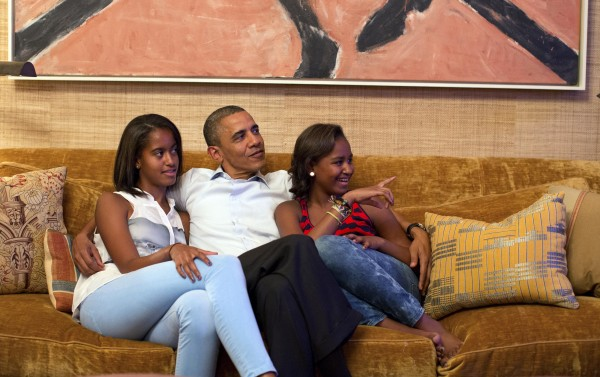 In this image released by the White House, President Barack Obama and his daughters, Malia (left) and Sasha, watch first lady Michelle Obama speak at the Democratic National Convention on television from the Treaty Room of the White House Tuesday, Sept. 4, 2012.