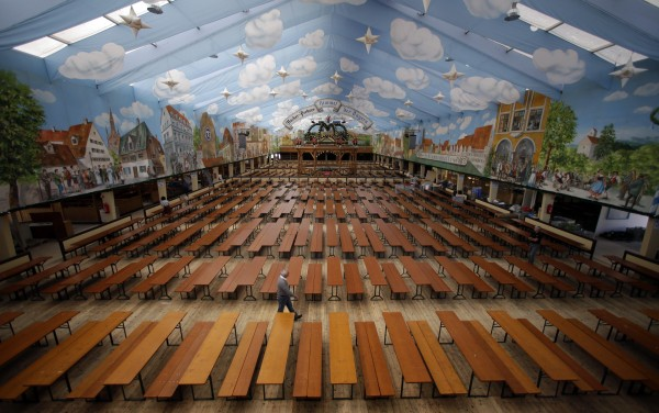 A man walks through the Hacker Pschorr beer tent during preparations for the 179th Oktoberfest beer festival in Munich, southern Germany on Tuesday, Sept. 18, 2012. The world's largest beer festival will be held from Sept. 22 to Oct. 7, 2012 and will be attended by millions of visitors.