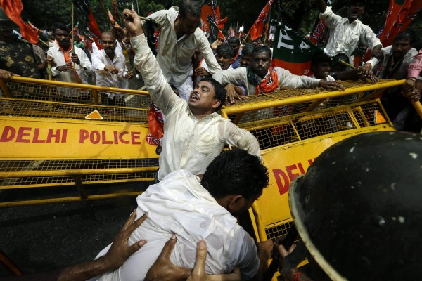 Supporters of India''s main opposition Bharatiya Janata Party (BJP) push through a barricade during a demonstration in favor of carving a separate state of Telangana from Andhra Pradesh state, in New Delhi, India, Tuesday, Sept. 4, 2012. Supporters of the new Telengana state have complained their area in the north was underdeveloped and ignored by powerful politicians from southern Andhra Pradesh. Demands for a separate state have erupted sporadically since the 1950s.